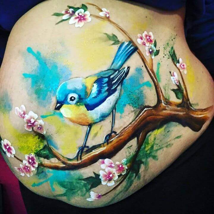Asymmetrical placement in belly painting